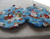 Snowman Hot Pads Set of Two Quilted Round Pot  Holder Snowmen on Blue Cotton Fabric Insulated Trivet 9 Inches on a Cream Background