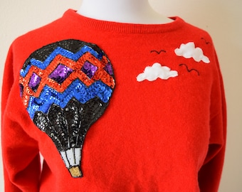 Up and Away Red Cashmere Sweater with Sequined Hot Air Balloon and Cloud Appliques (size small, medium)