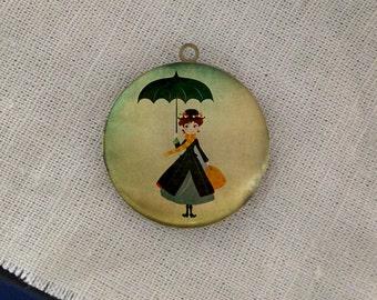 woman holding umbrella round antique brass locket 32mm (LD190)