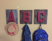 A, B, and C alphabet and hook on barn lumber