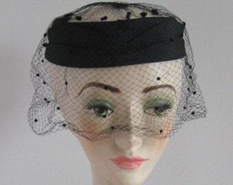 veiled black topper . ring hat with veil . polka dot veil . Mr. Joel hat