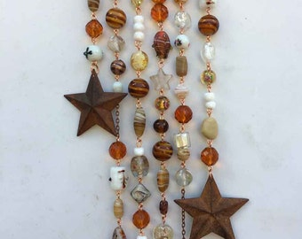 Suncatcher with Earth Toned Glass Beads, Crystals, and Rusty Tin Stars,