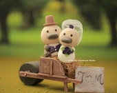 platypus Wedding Cake Topper with swallow-tailed coat, tuxedo and wedding dress