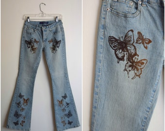 Vintage butterfly bell bottom jeans / butterfly embellished bell bottoms / hippie flare jeans