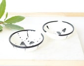 Pair of two small resin salt and pepper spice pinch trinket dish bowls in black and white.