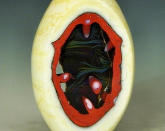 handmade lampwork glass bead an oval lapped focal bead with windows into the colorful core - Red Cavern