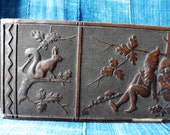 embossed vintage box with gnomes, hare, 4 leaf clovers