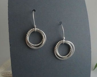 sterling silver circle earrings, Vortex twist dangle earrings, sterling silver earrings, dangle earrings.