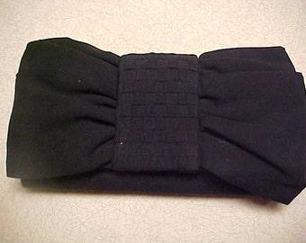 Black clutch purse- with thin plaited shoulder strap- designer ( Kate Lendry)