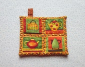burnt orange tea pots hand quiltled insulated potholder with loop to hang
