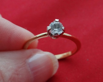 Vintage NOS new old stock goldr tone size 7 solitaire ring  in unworn condition
