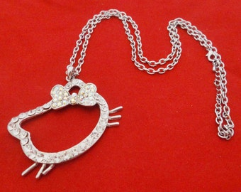 """Vintage silver tone 26"""" necklace with 2.5"""" aurora borealis coated rhinestone Hello Kitty pendant in great condition, appears unworn"""