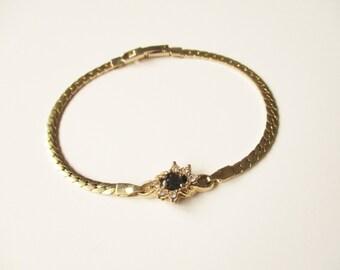 Gold rhinestone bracelet: Cute, simple 1960s yellow gold tone flat chain rhinestone flower statement bracelet, rhinestone flower bracelet