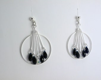 Black swarovskis and silver earrings