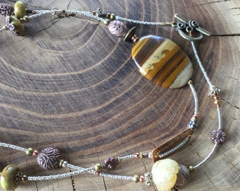 Tigereye, Amber and Silver beads with copper doodads.