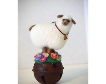 Balancing Act Wooly White Sheep On An Antiqued Metal Bell