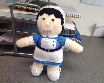 Hand knitted toy nurse