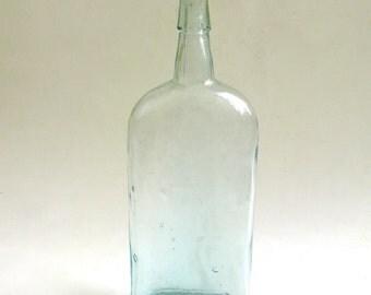 vintage bottle circa 1900  ... old glass bottle  ...  hand blown