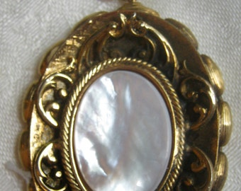 Vintage necklace, pendant is mother of pearl in ornate frame, beaded chain