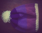 purple and white curly pom pom slouch hat