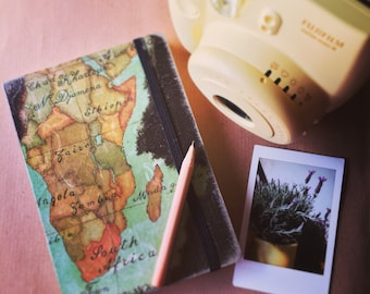 Travel journal with decoupage of Africa's map