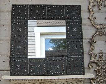 Vintage tin tile mirror. 2'x2'  Antique architectural salvage ceiling tin tile. Black wall mirror. Embossed pressed tin.