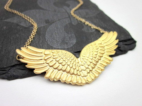 Gold wing jewelry gold wing necklace gold angel wing like this item aloadofball Choice Image