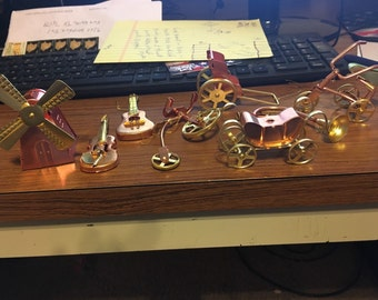 Vintage aluminum ornaments or little works of art. Guitar, violin, dutch windmill, rickshaw, carriage, french horn plus others.free shipping