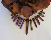 Distinctive necklace in purples and golds