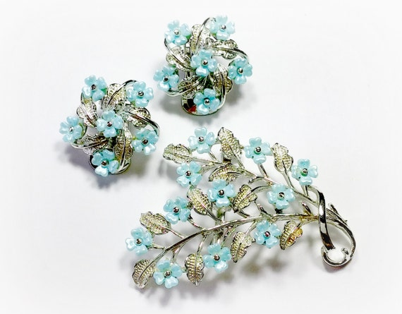 1950s Costume Jewelry Vintage Floral Earrings Brooch Set Frosted Blue Lucite Flowers Silver Tone Metal Pin and Clip On Style Earrings Delicate Graceful Appearance $28.00 AT vintagedancer.com