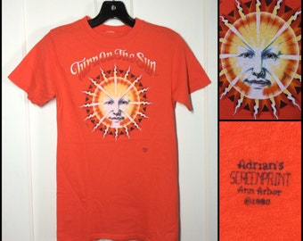 dated 1980 Orange Turn on the Sun Face T-shirt looks size XS 15x24.5 all cotton by Adrians Screenprint Ann Arbor