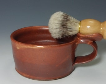 Slightly smaller shaving mug with orange shino glaze