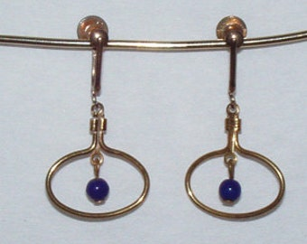 Vintage Oval shape gold tone clip on Earrings with tiny blue glass ball from 1970s