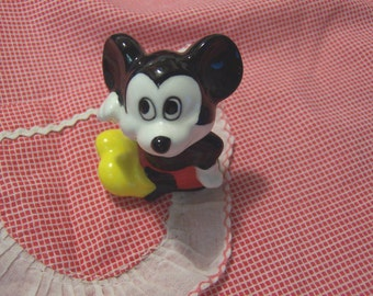 tiny mickey mouse figurine