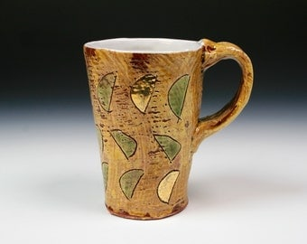 Tall mug with green and gold