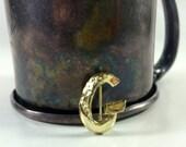 "Gold ""G"" initial pin"