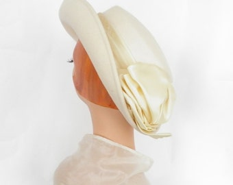 White fedora tilt hat, vintage with veil, satin trim. Rossi