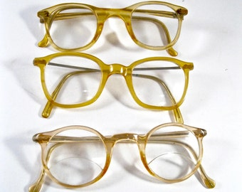 Lot of vintage plastic spectacles. 1940s 1930s eyeglass frames. Translucent peach tone glasses.