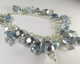 Swarovski Charm Bracelet in Light Blue and Shades of Gray in all Sterling Silver with adjustable chain and lobster claw clasp