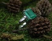 Platinum Emerald and Tapered Diamond Engagement Ring