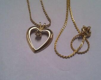 Costume Gold Tone Heart Necklace with Purple Rhinestone