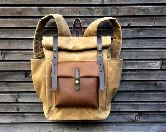 Waxed canvas backpack with roll up top and double bottle pocket  COLLECTION UNISEX