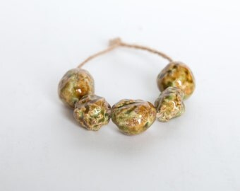 The clear body of spring -- a set of 5 green/brown ceramic art beads
