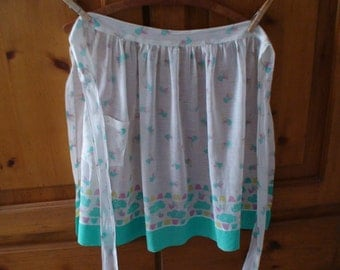 Mid-Century Handmade Pocketed Cotton Batiste Apron, Adorned with Angels and Teal Blue Bottom Border