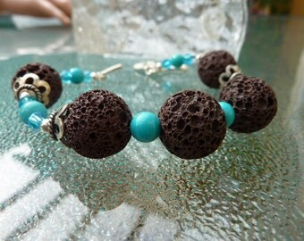 Bracelet: earthy brown Lava stone and semi precious turquoise with Tibetan Silver