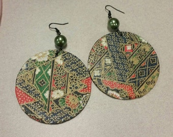 Large round asian theme earrings