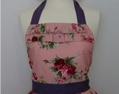 Retro apron with ruffles, dark pink flowers on a pink fabric. 1950s inspired, fully lined.