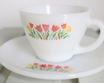 Vintage Fire King tea cups and saucer. Tulip flower pattern. White milk glass tea cups floral print. Tulips.