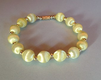 Satin Glow Bracelet Soft Yellow and Gold Beads