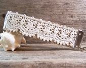 Key Fob / wristlet made with a pretty off white fobbing and romantic lace , very shabby chic and cute.